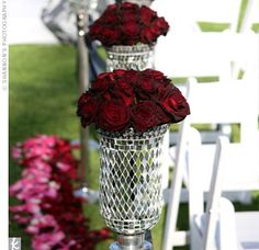 The aisle, made to look like a red-carpet movie premiere, was lined with mirrored vases filled with red roses.