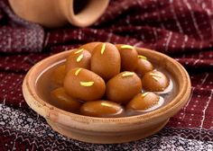 Gulab Jamun - 	 Pakistani Dishes You'd Love to Feast on