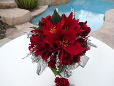 Bridal bouquet in red poinsettiasfrosted by AlwaysElegantBridal, $45.00