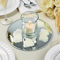 Add some reflection to your wedding centerpieces! Ideal for candles and collectible figurines, these 10 versatile mirrors have a variety of decorating uses. Mirror Centerpiece, Candle Centerpieces, Wedding Table Centerpieces, Wedding Decorations, Centerpiece Ideas, Anniversary Party Centerpieces, Rehearsal Dinner Centerpieces, Reception Table Decorations, Simple Centerpieces