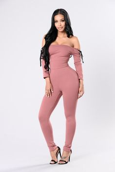 - Available in Red Brown - Off Shoulder - Skinny Leg - Jumpsuit - Lace Up Detail on Shoulders - Made in USA - 67% Rayon 29% Nylon 4% Spandex