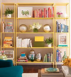 Colorful Library: Remove the jackets, then group books by color, standing some upright and stacking others. Shelves will seem more organized and have an artistic, color-blocked look. #goodhousekeeping #happyroom