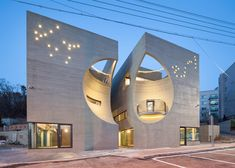 Concave facades on twin buildings by Moon Hoon create moon-shaped indents.