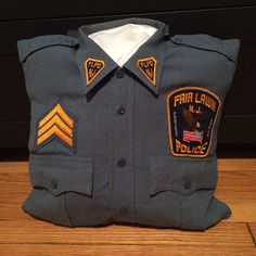 """I am starting """"Hero Pillows""""! I handmade this pillow out of one of my man's old uniform shirts. I moved the patches that were already on the shirt to create this decorative pillow! If you want one of your own, just send me a uniform shirt (with patches anywhere on it) and I will make you one for $25 (+shipping)! www.heropillows.wix.com/orders ***Tags*** Police / Pillow / First Responder / Gifts / Under $30 / Home Decor / Fire Fighter / Rescue / Police Shirts, Uniform Shirts, Police Patches, Police Crafts, Boy Scout Shirt, Navy Uniforms, Police Officer Gifts, Memory Crafts, Memory Pillows"""