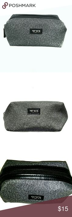 • {Tumi} Gray Travel Toiletry Bag •Tumi (for Delta) Toiletry Bag. Great for Men's Travel Nessisities for any Trip.  • Highlights: Gray Sturdy Exterior Material, Black Top Zipper, Black Satin Interior Fabric, Black Stitched Front Label Tumi Logo.  • NO DISCOLORATION/TEARS • EUC • DOG FRIENDLY & SMOKE FREE HOME • TRADE & OFFERS WELCOME Tumi Bags Luggage & Travel Bags