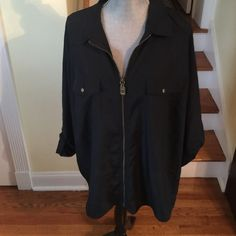 MICHAEL KORS BLACK ZIPPER SHIRT NWOT Size 3X-fits like a 2X- never worn. Gold hardware, adjustable sleeves. Can be dressed up or down! Price is negotiable, just ask  Michael Kors Tops Blouses