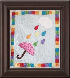 Rainbow Showers quilt. Cute for a little girl.
