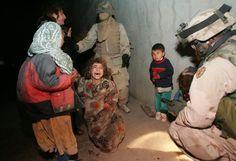 002_The Hassan Family; U.S. Troops Mistakenly Kill Iraqi Civilians- Chris Hondros