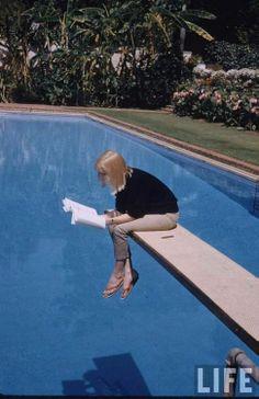 Actress May Britt reading over pool 1957 - Photographer: Leonard McCombe - LIFE