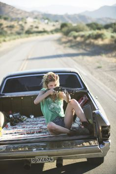 Shooting a big gun out of the back of an el camino..while still looking cute in cutoffs and boots?! I want to be this chick!!!