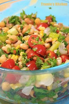 Bean salad: beans, corn, pickled pearl onions, cherry tomatoes, parsley, olive oil, lemon juice and zest, celery.