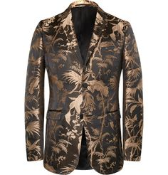 GUCCI Black And Gold Slim-Fit Jacquard Tuxedo Jacket This impressive Gucci tuxedo jacket is cut from rich black and gold jacquard cloth. It's woven with a generous lashing of silk for lustre, and cut in a streamlined slim fit for a polished appearance. The Eastern-inspired design is bound to be a captivating talking point at your next formal affair. Cap yours off with a velvet bow tie and glossy leather shoes.