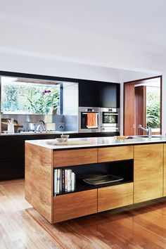 Timber kitchen from a Japanese-inspired home in Queensland. Photography: Alicia Taylor | Styling: Caro Toledo | Story: Australian House & Garden