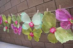 Great Idea for displaying party favor/fairy wings using twine and clothes pins.