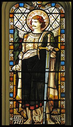 Stained glass window depicting St. Alban, the first martyr of England, in the chancel of Leicester Cathedral.