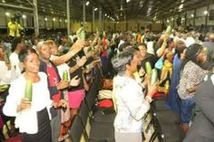Ladies excited as pastor shares anointed cucumbers during service [PHOTOS]