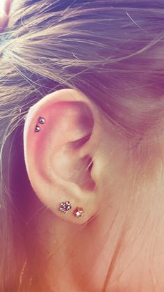 Fresh double helix piercing studs with first and second lobe piercings. Long hair. Pretty studs. Pinterest: @rosesaresmart Instagram:@coffeeloverscanada