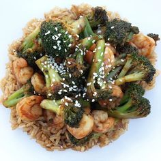 """Spicy shrimp and broccoli stir fry for supper! Served over 1/2C brown rice. Used Splenda brown sugar (it's a Splenda/sugar mixture), didn't have orange juice so left it out. Delicious! Recipe is pinned on my Pinterest, """"imlosinggravity"""" or found here: http://bakerbynature.com/20-minute-skinny-sriracha-shrimp-and-broccoli/"""