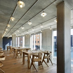 Called Nottingdale Cafe , the project involved adding a mezzanine level and creating a 10 meter-long bar clad in porcelain panels. London studioFound Associates have completed this restaurant with an oak and concrete interior in west London.