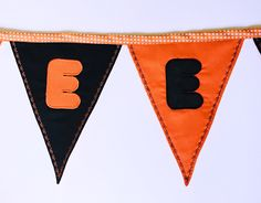 """Festive """"Happy Halloween"""" bunting with orange and black flags to last for years. Ideal for decoration during Halloween or a season's gift."""