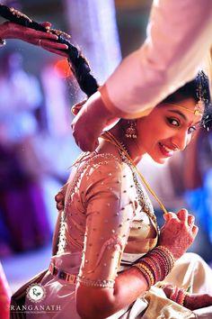 South Indian bride. Temple jewelry. Jhumkis.White silk kanchipuram sari.Braid with fresh flowers. Tamil bride. Telugu bride. Kannada bride. Hindu bride. Malayalee bride.Kerala bride.