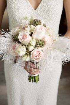 Take a look at the 15 inspiring feather wedding decorations in the photos below and get ideas for your wedding! Dipping feathers in glitter can add a magical feeling to your wedding decor. Place them in your bouquet, hair, or… Continue Reading → Bouquet Bride, Feather Bouquet, Flower Bouquet Wedding, Bouquet Flowers, Bridesmaid Flowers, Art Flowers, Flower Art, Roaring 20s Wedding, Great Gatsby Wedding