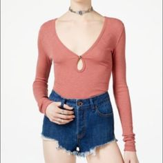 "FREE PEOPLE Cotton-Blend Knit Shirt A soft cotton blend knit with a front keyhole detail Deep V- neck Long sleeves Front keyhole with button closure About 21"" from shoulder to hem Cotton/modal/spandex Machine wash.  COLOR:Earth red Free People Tops Tees - Long Sleeve"