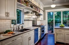 craftsman kitchen by Board and Vellum-always a fan of the timelessness of subway tile, white cabinetry and wood floors.