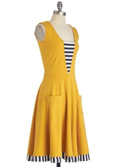 """Sleeveless yellow ponte knit dress with narrow square neck and low scoop back, navy & white striped V bodice inset, 2-piece knee-length A-line skirt set 1"""" below natural waist with self rounded patch pockets and navy & white striped hem. 95% cotton/5% spandex, by Effie's Heart, $89.99"""