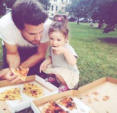 Father & daughter eating pizza