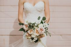 Blush, pastel bridal bouquet. White o'hara roses, silver dollar eucalyptus, parvafolia, white ranunculus, white and blush stock and white hydrangea. Photography by Sarah Rogers Photography