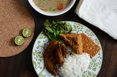 Indonesian Traditional Cuisine - Fried chicken with spices, fried tofu, fried tempe & Soto Betawi