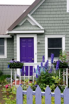 Love the grey house with the purple door