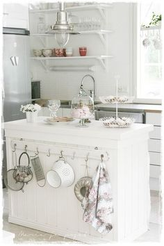 What a cute little kitchen! Love everything about it. Shabby Chic is adorable!