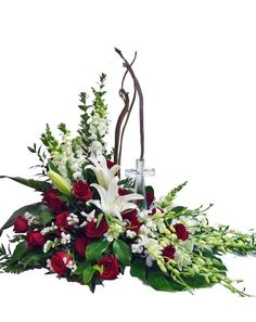 This is our most popular religious sympathy flower arrangement.  This Funeral flowers arrangement features a true keepsake crystal cross.