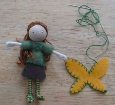 The Enchanted Tree: New Bendy dolls and Tutorial. Make your own bendy doll with pipe cleaner, wood bead and yarn.