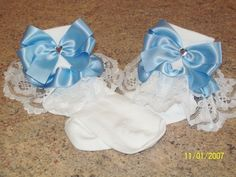 special occassion frilly socks these and trimmed with gathered white lace and blue satin ribbon. blue satin side bows with heart shaped diamonte detailing, can be made in any colour and to fit any shoe size. £5 from www.facebook.com/... matching accessories available