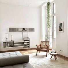 Bright and minimalist living room with a wooden armchair, a gray daybed and a high ceiling. Living Room Table, Interior Inspiration, Home And Living, Home Living Room, Interior Design, House Interior, Room Decor, Room Interior, Home Deco