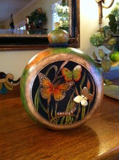 Carved Canteen with Butterflies. Another neat carved gourd.