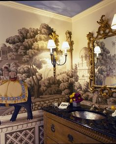 Ruthie Sommers A dramatic Chinoiserie wallpaper adds a real wow factor to a powder room.