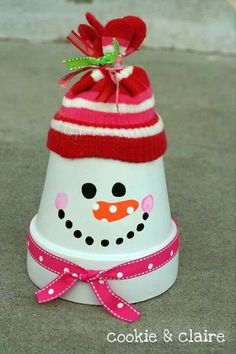 Paint terra cotta pot, use cheap glove or hat top, ribbon for scarf.