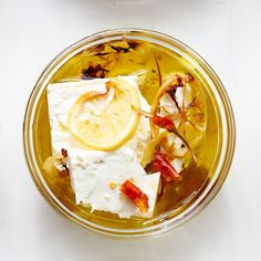 marinated feta with roasted lemon - for a mediterranean party - Try this with white beans on toast, in salads, or puréed and spread on pita. Beans On Toast, Feta, Marinated Cheese, Cooking Recipes, Healthy Recipes, Healthy Food, Dairy Recipes, Cheesy Recipes, Healthy Meals