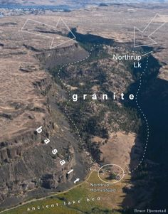 Upper Northrup Canyon, eastern Washington. Dashed outline is area of exposed granite. Block arrows show movement of Ice Age floodwaters that spilled over from the Columbia Valley to the north (visible at top of photo).