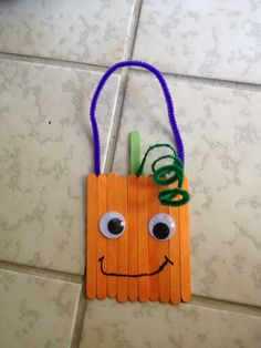 "Fall kids craft, Spookly the Square pumpkin popsicle stick door hanger. I love the movie ""Spookly The Square Pumpkin!"" This will be a fun craft to do after watching the movie. Fall Preschool, Preschool Crafts, Abc Crafts, Preschool Halloween, Party Crafts, Preschool Ideas, Teaching Ideas, Daycare Crafts, Classroom Crafts"