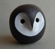 Whistle owl handmade ceramics. It is made of chamotte clay and covered white glaze, has a nice streamlined shape, perfectly fits in your hand. Owl emits a sonorous sound similar to the sounds of night birds and looks great in the interior of any home. This bird can be a unique gift for those who appreciate the natural beauty of nature. Size: height 73 mm length 80 mm width 70 mm Weight: 218 g