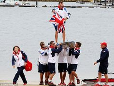 Windsurfer silver medal winner, Nick Dempsey, is carried onshore on his windsurf board by Team GB team mates