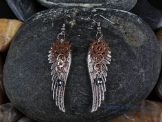 Check out this item in my Etsy shop https://www.etsy.com/listing/258175391/steampunk-earrings-angel-wing-earrings
