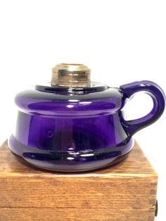 This listing is for a Genuine Amethyst purple pressed glass antique oil lamp from the late 1800s,with an elegantfinger loop. This lamp is petite with a single openinghandle. It isabout 3.5 tall to top of thebrass ring & just over 4in diameter atthe base.  It is in great clean workingcondition, with no chips orhazing. It does show some wear on the base and has a couple small scratches that may be from the manufacturing process  Please note, this does not come with aburner or…