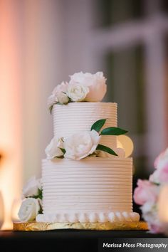 With such an abundance of sweets on display, the couple ceremoniously cut a simple petite cake.