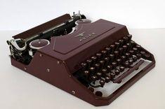 Portable typewriter Adler Favorit 2 with case in bordeaux
